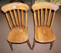 A pair of Elm High Wycombe dining chairs (makers mark on back of seats)