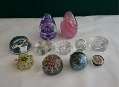 11 assorted paperweights