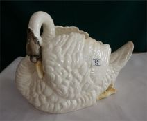 A Staffordshire pottery swan table centre piece (some restoration) 16 inches long 12 inches high