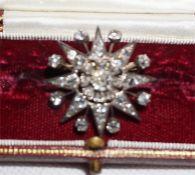 An eight ray star form Victorian diamond brooch