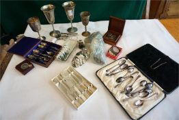 A box of assorted silver plated ware coins, ladies pistol compact, scent bottle etc.