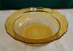 A bohemian Amber coloured glass punch bowl engraved with foliage, stage and ducks