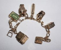 9ct Gold charm bracelet with 8 Gold charms