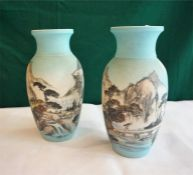 Pair of Oriental ceramic vases with landscape scenes, four figure mark to base.