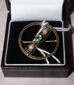 An early 20th century demantoid and pearl brooch