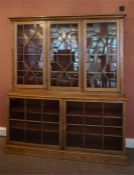 A pine bookcase with glazed doors