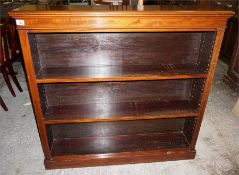 A late 19th early 20th Century open mahogany bookcase, shelved.