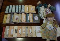 3 x Assorted dolls and a quantity of Beatrix Potter children's books and other books.