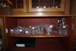 Collection of crystal ware including decanter, water jugs, vase, preserve pots,
