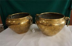 A pair of Indian Raj Brass Jardinieres, the surface engraved with figures in landscapes