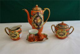 A Naritaki 3 piece porcelain coffee set and egg cruet