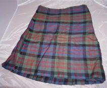 3 Kilts, 2 tartan 1 black, pair of tartan trousers, pair of white socks, shirt, tartan bowtie, sporr