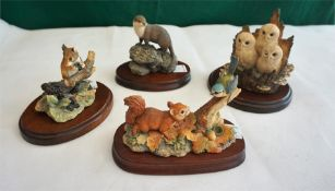 Four Border Fine Art models of Baby Squirrel, Bluetit, Baby Owls and Wood Mouse