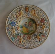 "A 15 1/2"" diameter Capo-Di-Monte wall plaque"