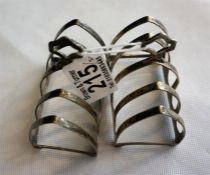 A pair of matching silver toast racks