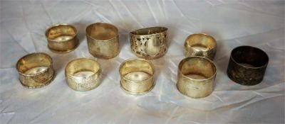 Nine Assorted silver napkin rings, 6oz