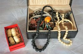 Group of bead necklaces and bone items in jewellery box