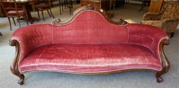 A late Victorian walnut framed parlour settee, with carved carved scrolled back