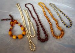 Nine assorted strings of glass and costume bead necklaces