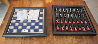 Battle of Waterloo chess set by the Franklin mint, comprising of 32 pewter pieces in fitted box