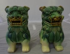 A pair of Chinese pottery dog of foe figures