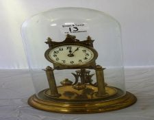 Brass 300 day mantle clock, with glass dome.