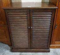 Modern shelved two door cupboard