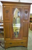 An Edwardian stained Ash mirrored door wardrobe, with single drawer to base