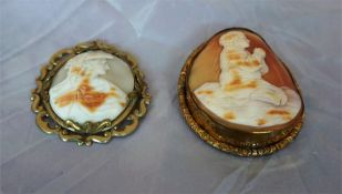 Two Victorian cameo brooches, one a female bust and the other a figure praying 6cm and 8cm high