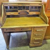 Single pedestal Oak S top Roll top desk, with fitted interior.