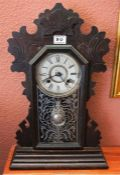 A Victorian American gingerbread mantle clock