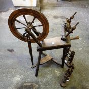 A fruitwood and ash Spinning wheel and two wool holders (3)