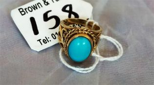 A ladies 9ct gold dress ring, set with a turquoise stone size L