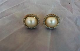 Pair of 18ct gold and stud pearl and diamond encrusted earrings, with all over small diamond stones