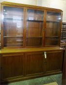 A large Mahogany bookcase, 3 glazed doors to top and 3 blind doors to base