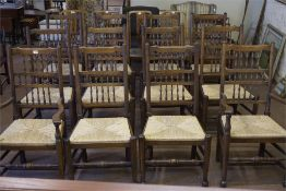 A set of 12 Lancashire style dining chairs