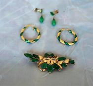 Five pieces of unmarked gold and jadeite jewellery