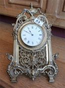 Late Victorian French brass strut mantle clock, raised on a folding easel support