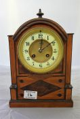 A walnut cased Mantle Clock, with 8 day movement, striking on bell
