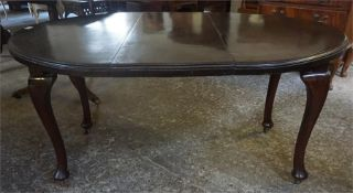 An Edwardian mahogany D-End extending dining table