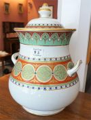A large Victorian two handled baluster shaped vase with lid, decorated with bands of