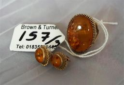 A ladies gold dress ring, set with a large amber coloured stone plus a pair amber of earrings, (3)