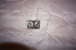Vintage silver double photo locket and chain, foliage design. Assayed 1970