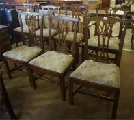 Seven Georgian Oak dining chairs
