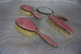 Silver and pink enamel 4 piece dressing table set, comprising of two ladies brushes,