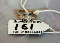 A ladies diamond and sapphire dress ring set in yellow gold