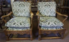A pair of Arts and Crafts style oak cottage style arm chairs