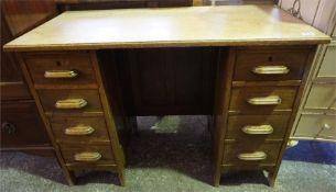 An Edwardian Oak kneehole desk, with 8 drawers