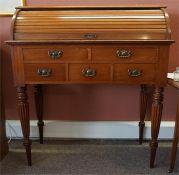 A Victorian mahogany cylinder roll top desk / bureau