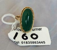 A 9ct gold ladies dress ring, set with a green agate, stone size K1/2